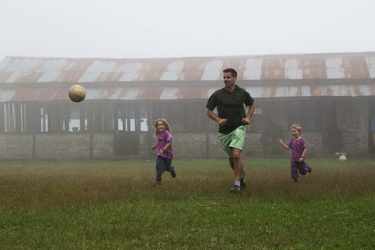 Family playing football at Australian Camp, Nepal
