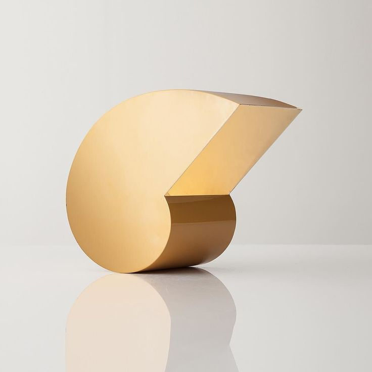 take it easy with the snail table lamp in yellow lacquered metal designed by graimondi