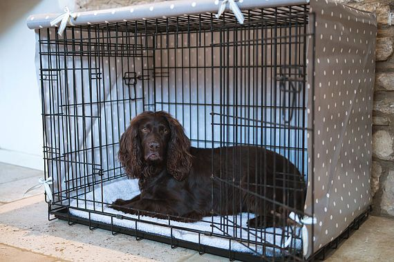 Your dog deserves the best. This made to order dog crate cover will ensure that your dog feels safe and secure in his crate and that his crate doesn't become an eyesore in your home. Featuring attractive ribbons to tie up the front your crate cover it will look stylish in your home. Simply untie the ribbons to drop the door down so that at night your dog isn't disturbed and has a super lovely nights sleep. Made from Clarke and Clarke oilcloth our handmade pet crate covers are easy to keep…