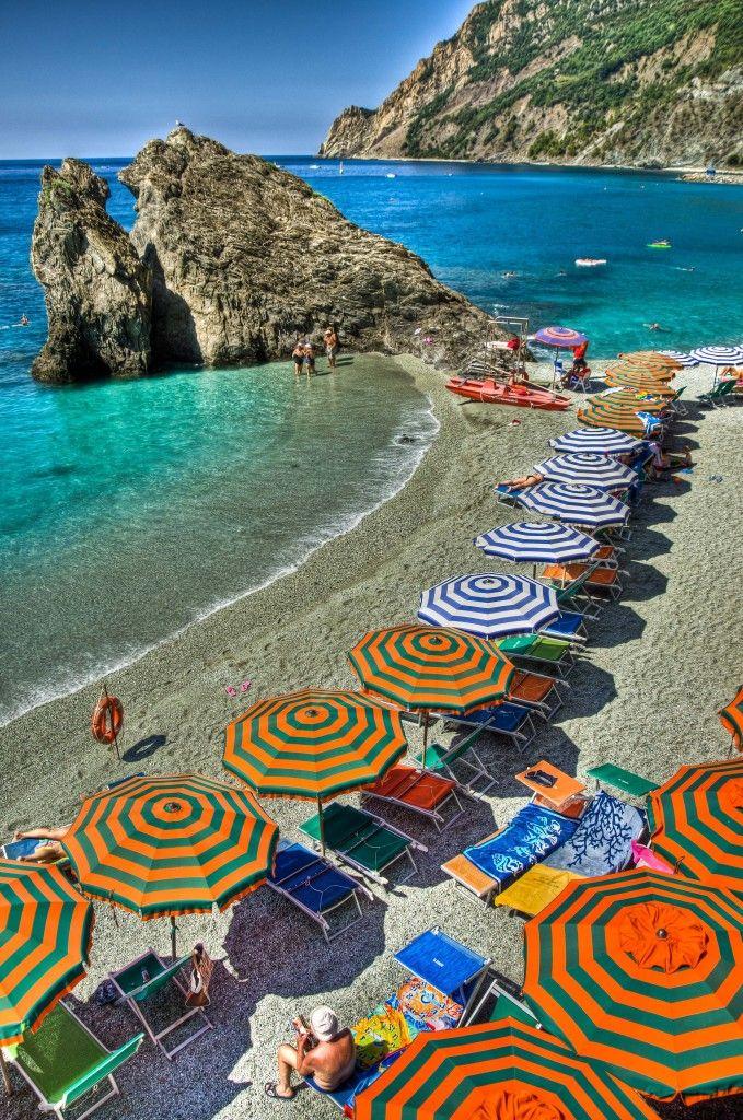 Monterrosso's beach, Cinque Terre, Italy. Arcobaleno di ombrelloni :) #essenzadiriviera.it