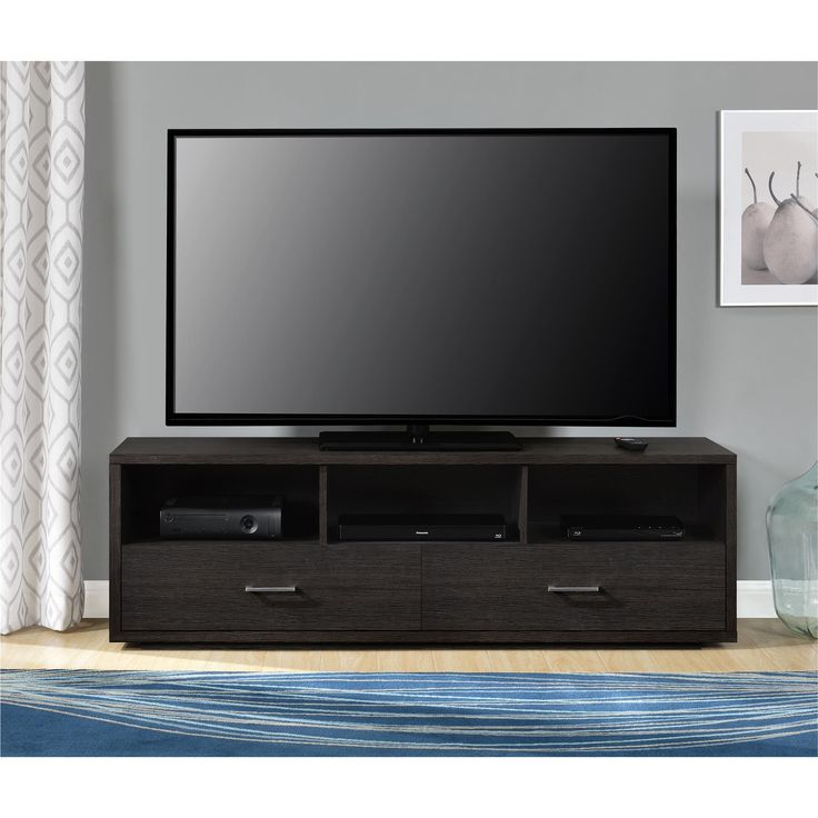 The Altra Clark 70-inch TV Stand helps to make a statement in your living room. This large TV Stand accommodates flat panel TVs up to 70 inches wide so your TV viewing can emulate a theater. The warm