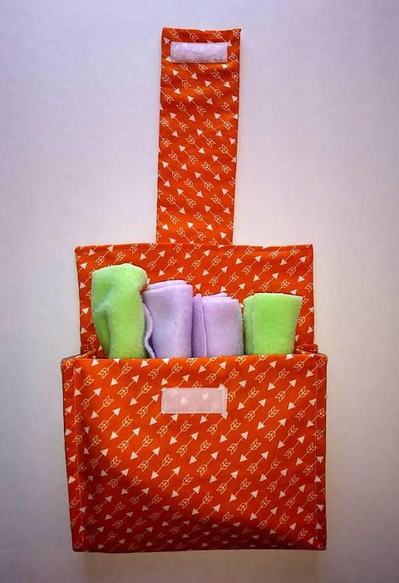 Check out this item in my Etsy shop https://www.etsy.com/listing/552820317/orange-baby-shower-baby-bib-holder-arrow