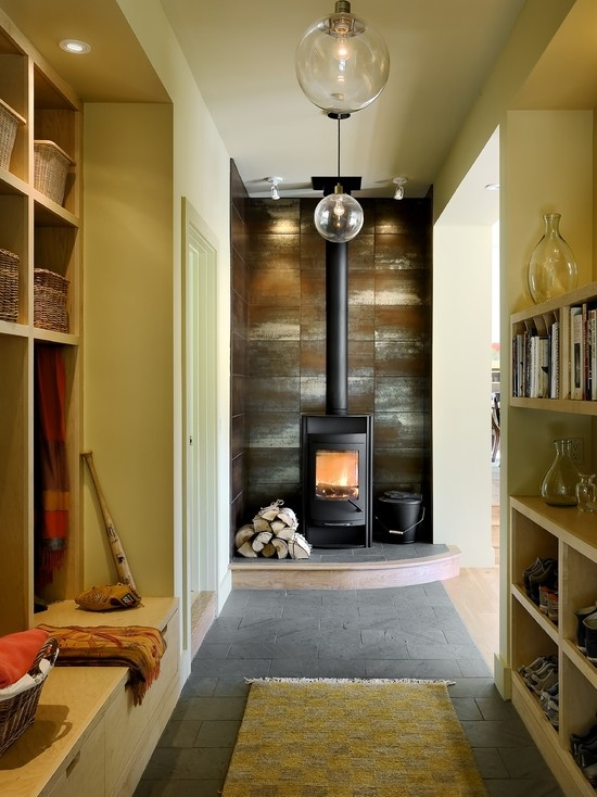 modern wood stove on a slight dais exhaust pipe through ceiling could heat sleeping