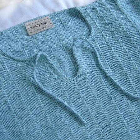 Slipped rib stitch and I-Cord neck detail.