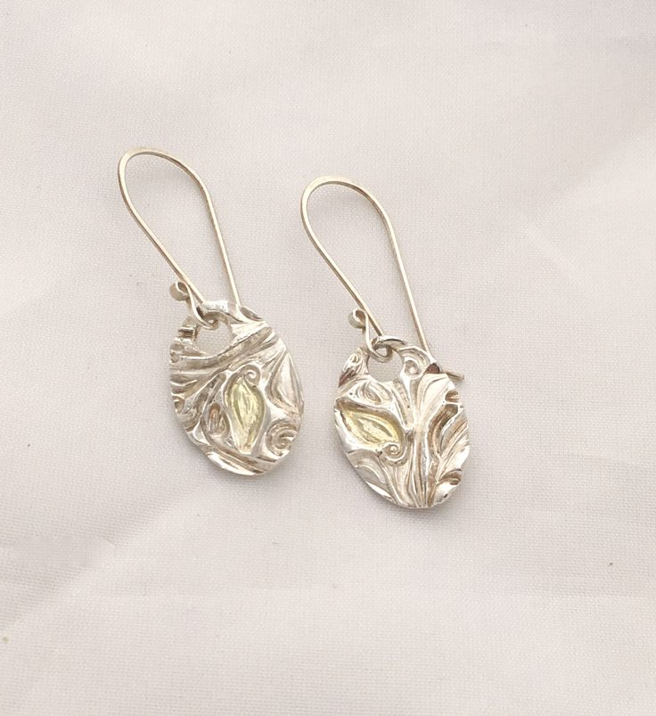 Pure silver and gold 14ct embossed leaf Earring by NuitNuitDesigns on Etsy https://www.etsy.com/uk/listing/547855165/pure-silver-and-gold-14ct-embossed-leaf