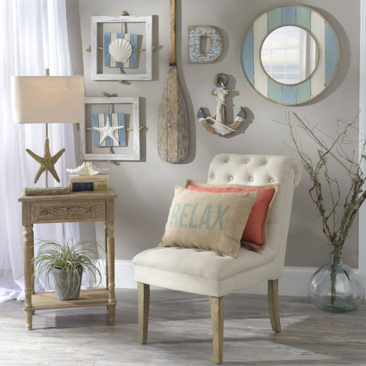 Decorate your home with your love of the ocean! Shells, coastal colors, sea animals and more are available in our Seaside Retreat Collection.(chair and pillows)
