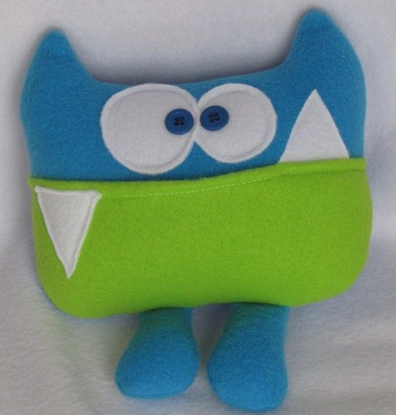 Gavin has this and loves it!    Tooth Fairy pillow  Sherman the tooth fairy by kookycritters, $17.00. According to the description: Sherman has his degree in Criminal Justice. He was head of security at the Emerald Square Mall for 6 years before he took his current position as Tooth Fairy Pillow. He takes his new role very seriously; you can be sure that your tooth as well as the treasure the tooth fairy leaves behind is safe with Sherman!!