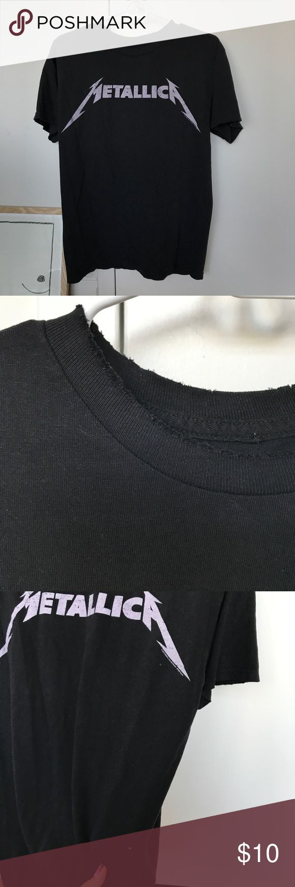Brandy Melville Metallica shirt Distressed Metallica shirt. There is a hole in the shirt on the front (came like that). Sleeves and collar is also distressed. SUPER CUTE! (Could turn it into a cute rock band Halloween costume)  Brandy Melville Tops Tees - Short Sleeve