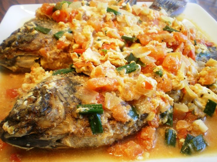 """Sarciadong Isda literally translates to """"Fish with sauce"""". Fried fish is simmered in a sauce that is usually composed of tomatoes and onions; some seasonings are also added to enhance the flavor."""
