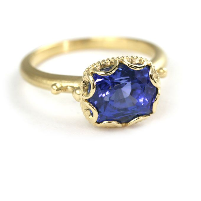 "Brides.com: Unique Engagement Ring Settings. ""Scalloped Bezel"" engagement ring set in 18K yellow gold with a cushion-cut blue sapphire, price upon request, Megan Thorne  See more yellow gold engagement rings."