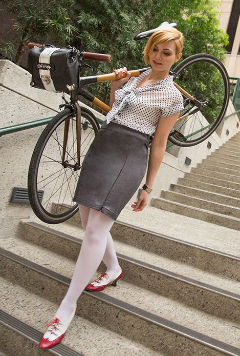 Sh** bike commuters do: carrying the Bambeauty down a flight of stairs while wearing the Bike To Work Skirt. Cameo by the Bike Pretty Satchel.