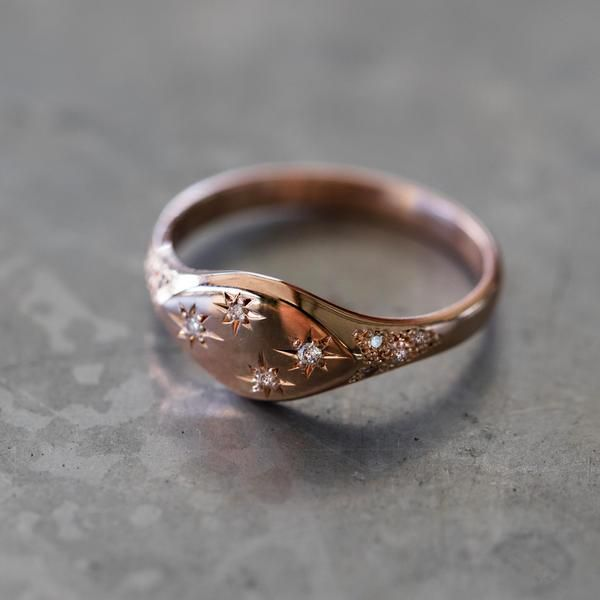 14kt gold and diamond It's Written in The Stars vintage signet ring **has four diamond starburst **features scattered diamonds on the sides of the band ** Inspired by the pattern of the swirling stars