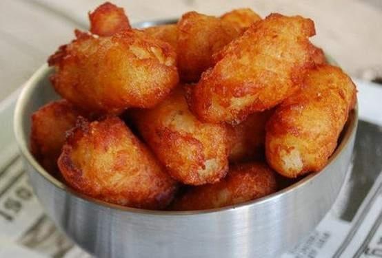 deep fried bacon-wrapped wienies in a buffalo fritter. Sounds kinda gross...maybe chicken?