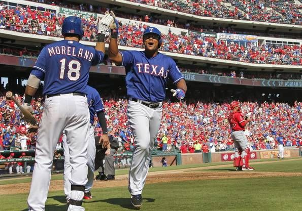 Texas Rangers third baseman Adrian Beltre (29) is greeted by Mitch Moreland (18) after hitting a two-run homer in the fifth that put the Rangers ahead for good in their 9-2 division-clinching win during the Los Angeles Angels vs. the Texas Rangers major league baseball game at Globe Life Park in Arlington on Sunday, October 4, 2015. (Louis DeLuca/The Dallas Morning News)