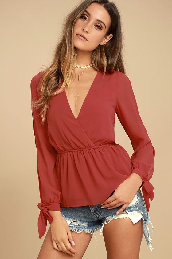 Lulus Exclusive! We can't help but be drawn to the Mutual Attraction Red Long Sleeve Top! Lightweight Georgette shapes a plunging surplice neckline and long sleeves with slits and tying cuffs. Elasticized waist and flirty peplum hem.