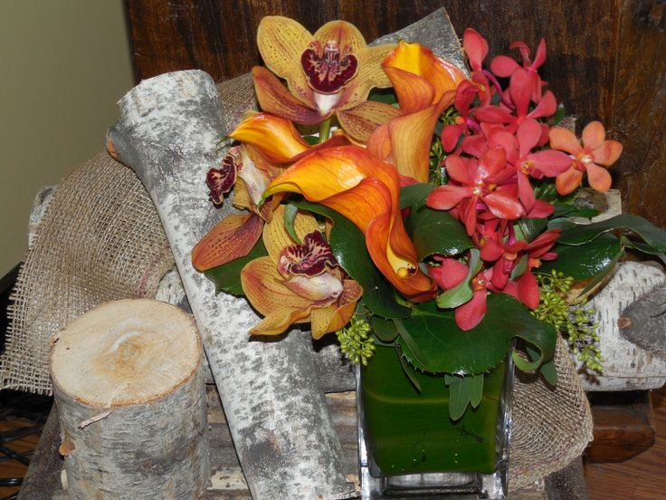 Mango mini calla lilies and assorted orchids are a beautiful choice!