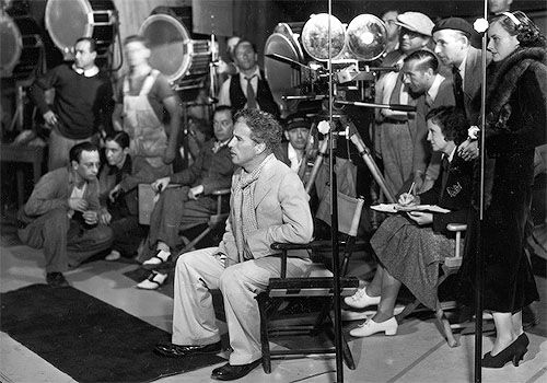 Charlie Chaplin directing on the set of Modern Times (1936), with co-star Paulette Goddard pictured on the right. (x)