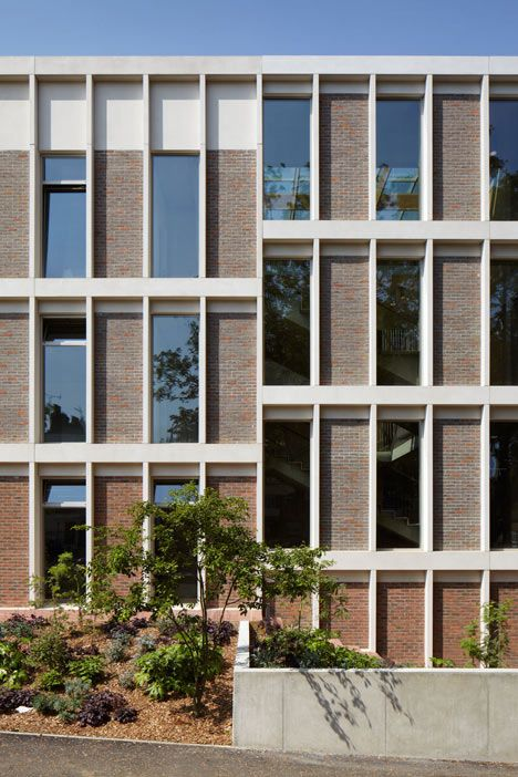 ORTUS by Duggan Morris Architects -  a community facility in south London that combines exposed concrete frames with raw brickwork and warm oak. Image via Dezeen.