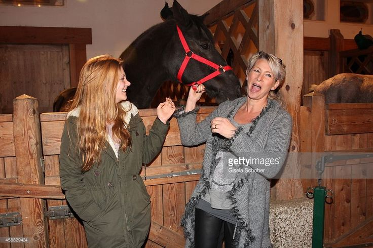 Claudia Jung and her daughter Anna Singer (L) during the Opening of the Gut Aiderbichl Christmas Market on November 11, 2014 in Henndorf am Wallersee, Austria.