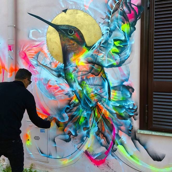 Street artist's chaotic rainbow colored birds brighten up the city