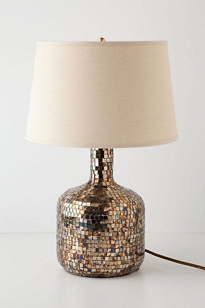 Buy mirrored glass tiles and apply to ugly old porcelain or eighties pottery lamp for a totally updated style