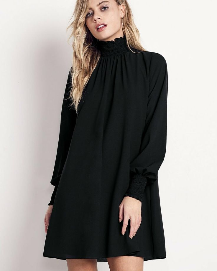 The Ali & Jay Doing Big Things Mini in Black is a shift dress featuring a smocked neck, voluminous sleeves and a key hole back.