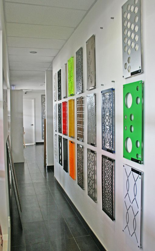 An array of sample-sized screens in a variety of materials and designs line our hallways in the QAQ reception area. #decorativescreens #hallway #privacyscreens