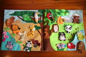 Quiet Book. Insanely cute animals. This lady also made a marble maze as a page in her Fairy Quiet Book.