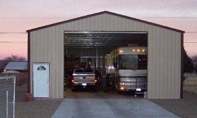 A BIG Metal RV Garage Big Enough To House Their And Second Vehicle With Plenty Of Space Left Over For Storage Work Areas