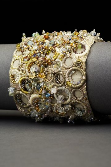 I so love this beaded, stitched cuff. So idea how it's made, but certainly some techniques I would love to explore!