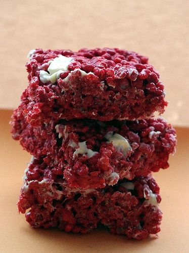 Red velvet Rice Krispie treats  3 tbs unsalted butter  1/2 cup Red Velvet Cake Mix  3 cups mini marshmallows  6 cups Rice Krispies  1 cup white chocolate chips  In a large saucepan over medium heat melt the butter, add cake mix and marshmallows. Once melted, stir in the Rice Krispies and half of chips. Don't over mix or they'll melt.  Press into the prepared pan using a greased spatula or baking paper. Press in the rest of the chocolate chips on top.