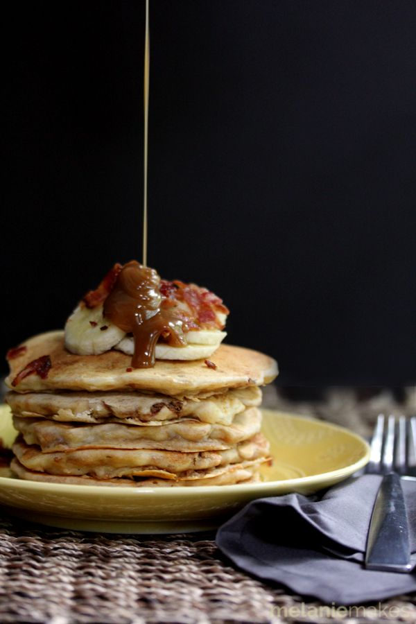 These Peanut Butter Banana Bacon Pancakes taste as good as they sound, especially when topped with Peanut Butter Maple Syrup! Flapjacks flavored with banana and melted peanut butter and then studded with bacon. You'll wish it was breakfast all day long!