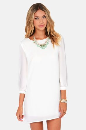 Check it out from Lulus.com! Try as they might, those other shifts just can't compare to the World's Greatest Ivory Shift Dress! Lightweight, woven material forms the perfect shift silhouette, with a high, rounded neckline, and three-quarter length, puffed sleeves with cuffs. Dress is lined; sleeves are slightly sheer. Model is wearing a size small. Dress measures 1.5
