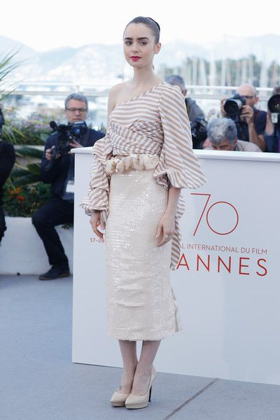 """Lily Collins Photos Photos - Actress Lily Collins attends the """"Okja"""" photocall during the 70th annual Cannes Film Festival at Palais des Festivals on May 19, 2017 in Cannes, France. - 'Okja' Photocall - The 70th Annual Cannes Film Festival"""