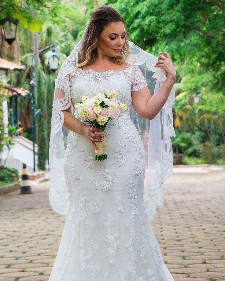 This slightly off the shoulder plus size wedding dress hass short cap sleeves.  Fuller figured brides searching for custom #plussizeweddingdresses will like this beaded lace option a lot.  Custom designs and #replicas of couture #dresses for way less than the original are all options with our US dress design firm.  Pricing and more detaisl on our process can be obtained when you email us from our official website at DariusCordell.com