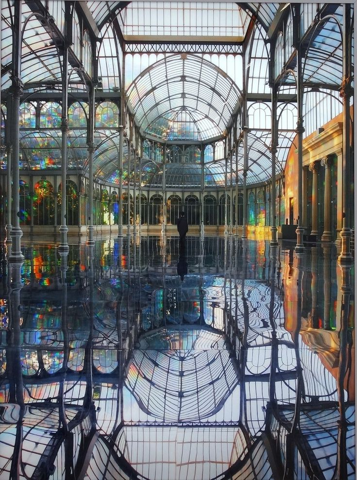 Kimsooja (b. Daegu, Korea, 1957, South Korean) - A Reflective Palace Of Rainbows, 2006   The Palacio de Cristal was originally built in the late 1880s in Madrid, Spain. In 2006 artist Kimsooja transformed it into this rainbow reflecting palace.    Installations