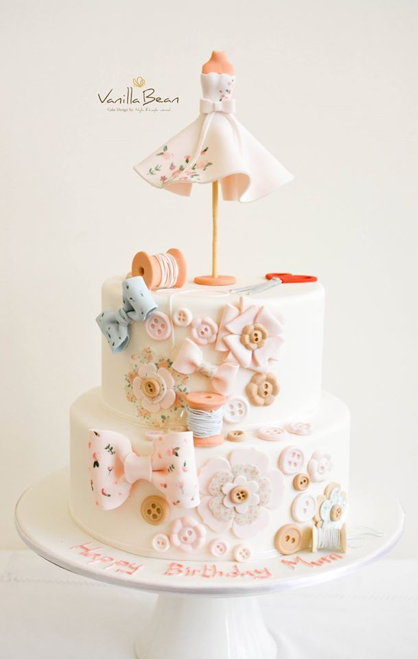 Cute sewing-themed tiered cake.