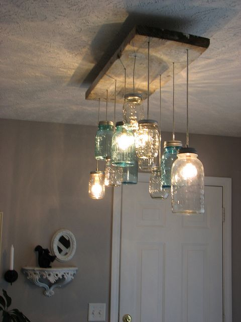 Love this but instead use a HUGE wine jug as one chandelier !! For the cabin !