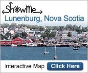 Lunenburg, Nova Scotia:  Food is great, views are awesome and good place for whale watch.  Great artisan shops.