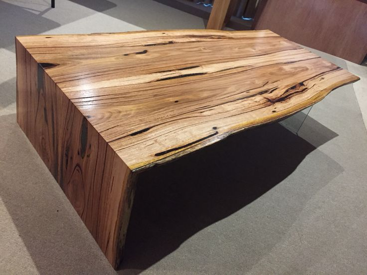 Messmate natural edge coffee table with glass leg