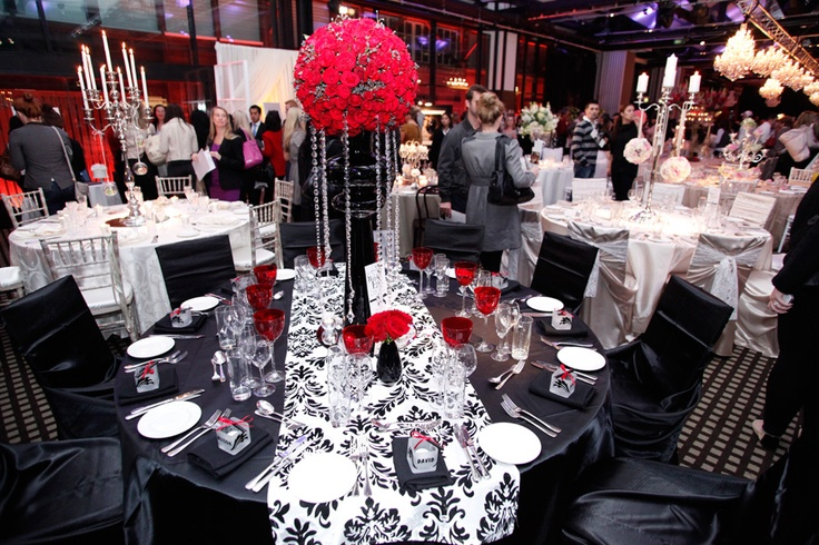 Black Table Cloth, White And Black Damask Table Runner, And Tall Red Flower  Centerpiece