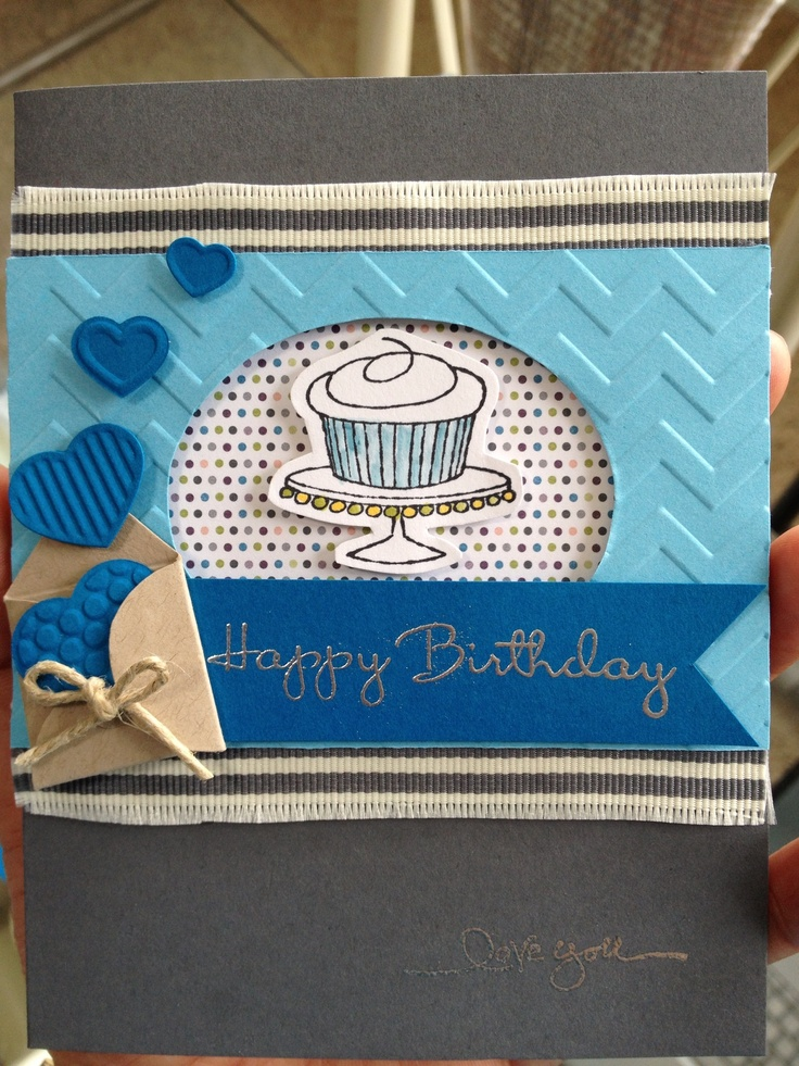Handmade birthday card. More masculine. Used the cupcake stamp from Stampin' Up Easy Events stamp set, Basic Grey Ribbon grosgrain striped, basic grey and pool party card stock, and dark blue card stock. Embossed with the chevron folder and heat embossed in silver. Used Fashionable Hearts Embosslits and a small envelope template. Nursery Nest DSP.