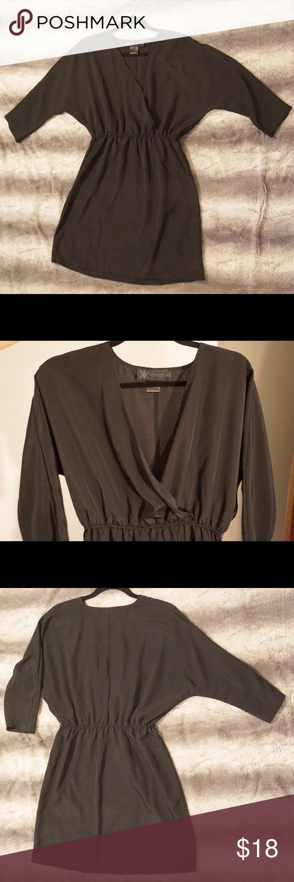 Kardashian Kollection Black Dress Really good condition black dress that is perfect for accessorizing!  Loose fit styled top portion with elastic waistline and about 3/4 sleeves.  Feel free to ask for any measurements if interested! Kardashian Kollection Dresses Midi