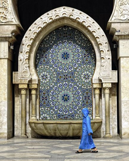 Morocco is filled with magnificent public fountains, a requirement of the ablutions needed before prayer in Islam.  This fountain shows artful  Moroccan mosaic tastir tile patterns within a large sculpted keyhole arch - a shape believed to ward off the evil eye. You can learn more about Moroccan architecture & design in my book, Marrakesh by Design: http://www.amazon.com