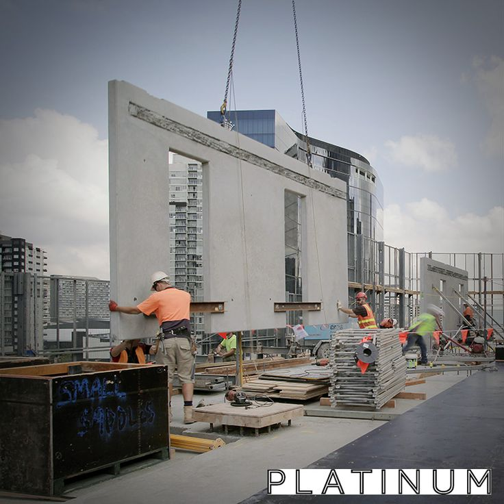 Platinum Tower construction photo: Pre-cast walls being installed.