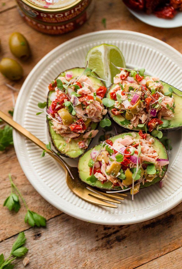 Italian Tuna Avocado Boats - fresh tuna salad made with Bella Portofino extra virgin olive oil packed yellowfin tuna, olives, sundried tomatoes, parsley, and lime served in avocado boats. An easy, healthy, dairy free, gluten free, and paleo friendly recipe!