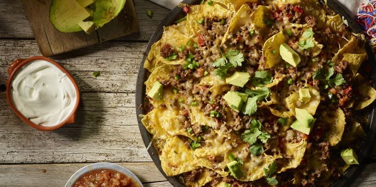 What's better than sharing a big plate of steamy nachos overflowing with flavors and savory ingredients? The only thing that could improve that scenario is to add more melted cheese! Our nacho recipe hits all the right flavors; from savory beef simmered in a zesty salsa to the double layers of Sargento® Traditional Cut Shredded Sharp Cheddar Cheese.