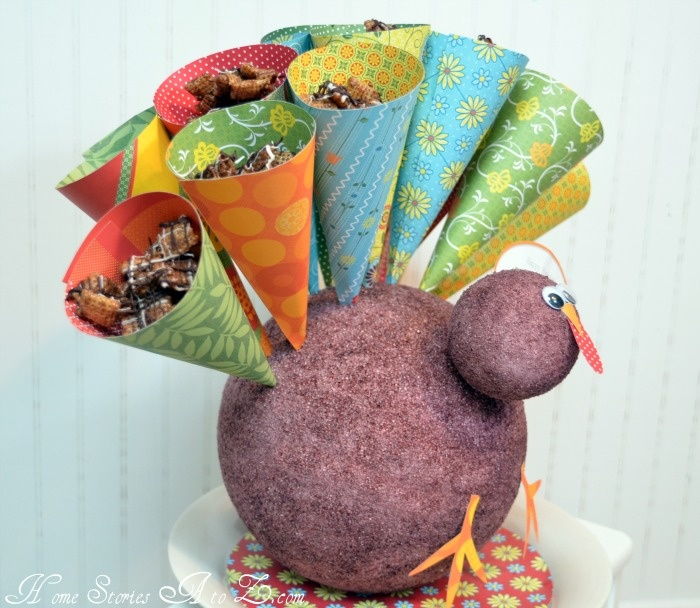 Treat Turkey! Paper cones filled with carmel/chocolate chex mix. very cute.