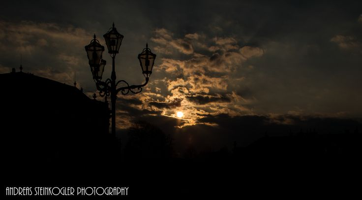 royal sun - This shot was taken in front of Vienna's Schönbrunn Palace, more precisely, building extensions of it and shows the beginning sunset at 5:30 pm. The lantern and the roofs are typical for the royal atmosphere which can be felt if you are standing near the palace.