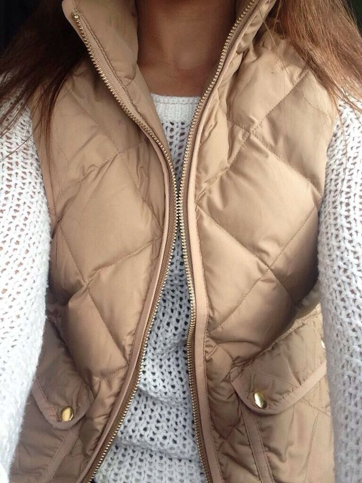 Tan vest & cream sweater.